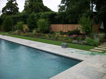 Southampton pool patio contractor stone patios poolscapes for Pool design long island ny